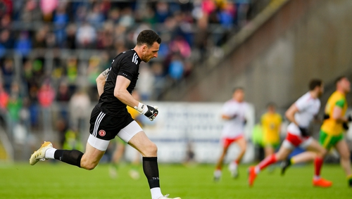 Tyrone goalkeeper Niall Morgan returns to his goal after making a break up the pitch