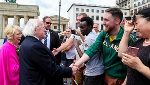 President Michael D Higgins greets well-wishers at the Brandenburg Gate in Berlin