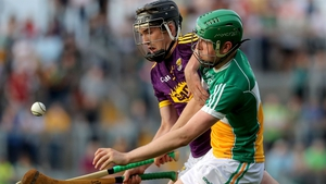 Wexford's Conor Scallan battles with Brian Duignan of Offaly