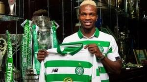 Boli Bolingoli-Mbombo poses with his new club's shirt. Photo: Celtic FC