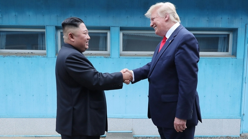 Kim Jong-un and Donald Trump  on the border in the truce village of Panmunjom in the Demilitarised Zone