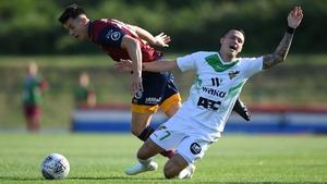 Mayron De Almeida of FC Progres Niederkorn (R) is tackled by Jordan Lam of Cardiff Met FC