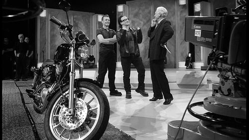 Larry Mullen Jr and Bono present Gay Byrne with a Harley Davidson on his last Late Late Show in May 1999
