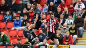 Michael Duffy of Dundalk Jamie McDonagh of Derry City battle for possession