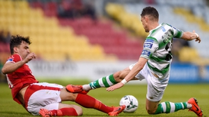 Graham Cummins of Shamrock Rovers in action against John Mahon of Sligo Rovers
