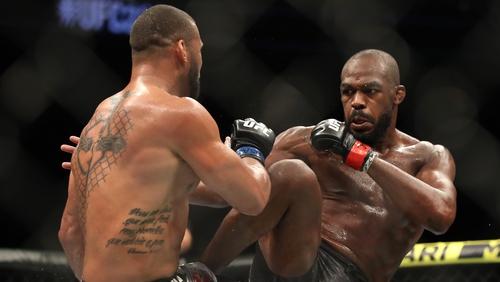 Jon Jones kicks Thiago Santos during the main event at UFC 239