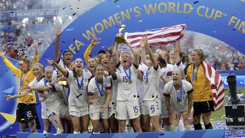 Co-captain Megan Rapinoe lifts the World Cup following the USA's victory over the Netherlands