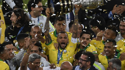 Brazil celebrate with the trophy after securing their ninth Copa America win