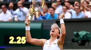 Johanna Konta celebrates after defeating Petra Kvitova