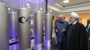 Iranian President Hassan Rouhani (right) inspecting nuclear technology in April 2019