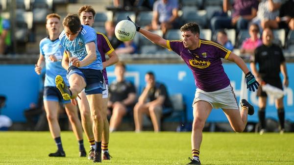 Ross McGarry fires over a point for Dublin