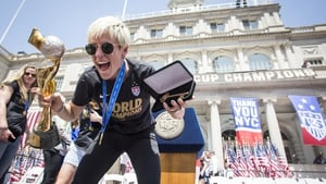 Rapinoe celebrating at the ticker tape parade