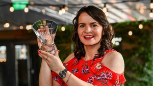 Geraldine McLaughlin pictured with her award