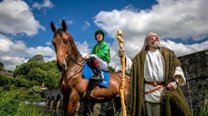 Jockey Colin Keane and Ruari O'Coileain in medieval garb  by the banks of the River Boyne