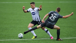 Dundalk's Patrick McEleney in action against Tomislav Saric of Riga