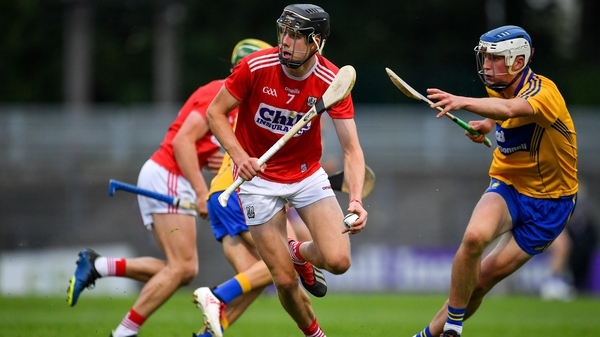 Cork's Robert Downey breaks clear of the challenge of Diarmuid Ryan