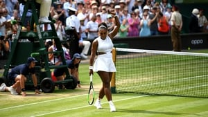 Williams celebrates after defeating Barbora Strycova