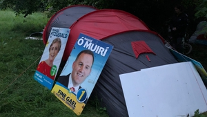 Christine and Derek use election posters as extra bedding and 'walls' for their tent
