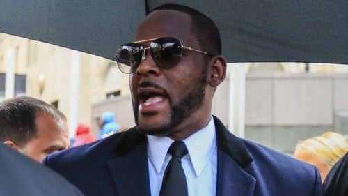 R Kelly pictured leaving a courthouse in Chicago in June