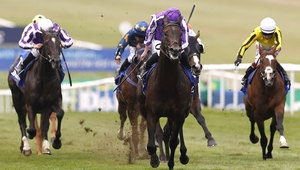 Ten Sovereigns and Ryan Moore (centre) on their way to victory in the Darley July Cup Stakes