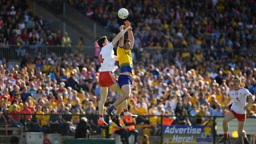 Diarmuid Murtagh of Roscommon takes to the skies with Rory Brennan of Tyrone