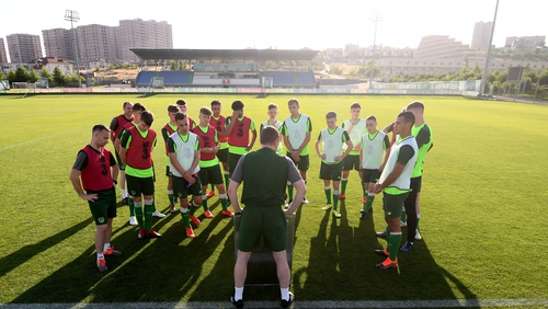 Tom Mohan speaks to his Ireland players at training
