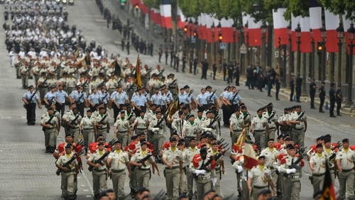 French soldiers take part in the Bastille Day military parade down the Champs-Elysees avenue in Paris