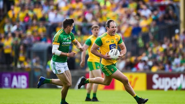 Michael Murphy of Donegal in action against Ethan Devine of Meath
