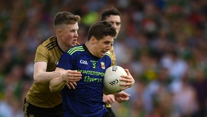 Lee Keegan of Mayo is tackled by Jason Foley of Kerry