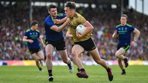 David Clifford of Kerry is challenged by Brendan Harrison
