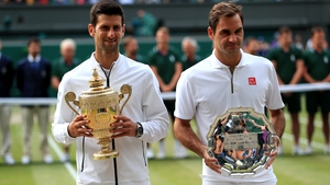 Djokovic (L) beat Federer in last year's Wimbledon men's singles final, the longest in history