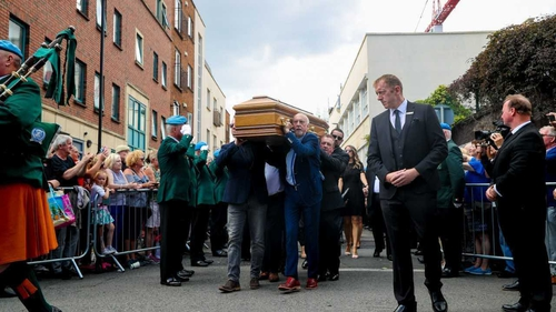 Hundreds of fans lined the street as Brendan Grace's coffin was led into the church