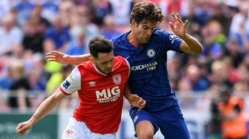 Eric Molloy challenges Chelsea's Marcos Alonso for the ball while trialling with St Pat's