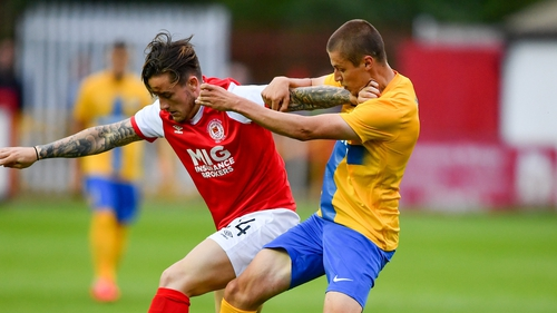 Rhys McCabe of St Patrick's Athletic in action against Simon Thern of Norrkoping