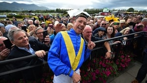 Frankie Dettori poses with racegoers during day 3 of the Killarney Racing Festival