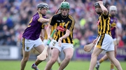 Eoin Cody of Kilkenny and Jack Reck of Wexford battle for possession