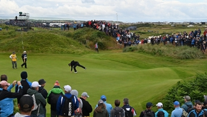 Lowry sinks a putt on day one at Royal Portrush