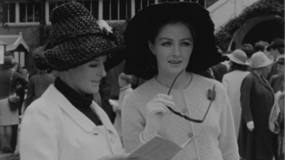 Two fashionably dressed women at the Dublin Horse Show Ladies Day (1964)
