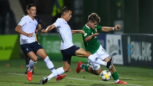 Matt Everitt of the Republic of Ireland in action against Maxence Caqueret