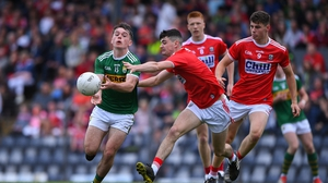 Killian Falvey of Kerry in action against Michael O'Mahony of Cork