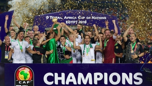 Algeria celebrate with the trophy following the victory