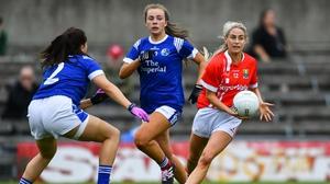 Cork's Orla Finn is closed down by Cavan defender Kate McIntyre