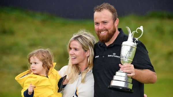Shane Lowry celebrates victory with wife Wendy and daughter Iris