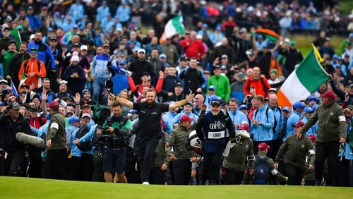 Shane Lowry takes the acclaim of the crowd on the final hole