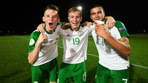 Andy Lyons, left, Brandon Kavanagh and Ali Reghba celebrate the 2-1 win over Czech Republic