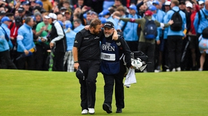 Shane Lowry chats to his caddie Brian 'Bo' Martin as they come down the last fairway at Royal Portrush