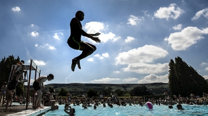 People of Yorkshire, England enjoy some rare time by the pool