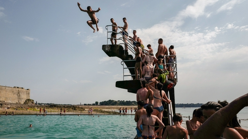 People queue to dive into the landmark sea pool of Saint-Malo, Brittany, France