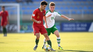 Vitor Ferreira of Portugal and Brandon Kavanagh battle for possession