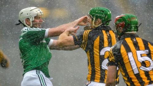 Tom Condon of Limerick does battle with Kilkenny's Henry Shefflin
